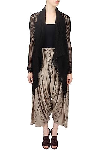 Ivory shibori printed pleated salwar pants by Urvashi Kaur