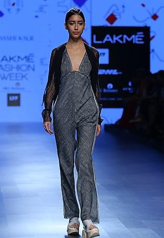 Grey deep neck jump suit by Urvashi Kaur