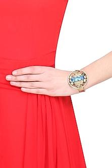 Gold finish semi precious stone round motif cuff by Valliyan By Nitya Arora