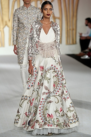 Ivory Embroidered Asymmetrical Lehenga, Blouse and Jacket Set by Varun Bahl