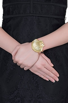Gold plated shell cuff by Valliyan by Nitya Arora