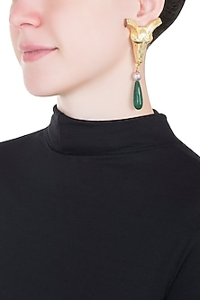 Gold plated ram head green stone earrings by Valliyan by Nitya Arora