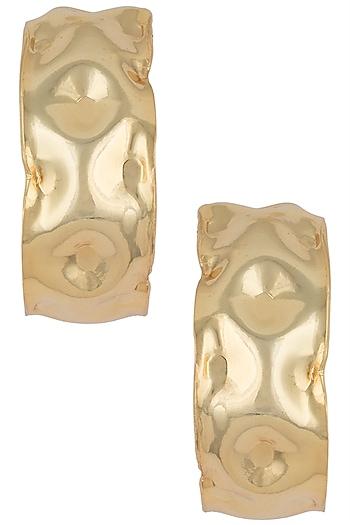 Gold plated textured hoop earrings by Valliyan by Nitya Arora