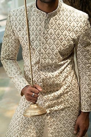 Beige Hand Embroidered Sherwani Set by Varun Chakkilam Men