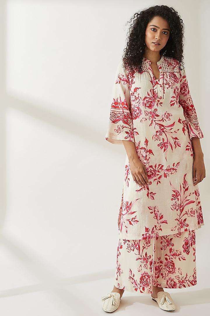 Pink Floral Printed Trousers by VIAM