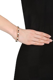 Gold Plated Black Onyx and Carnellian Insectopedia Bangle by Varnika Arora