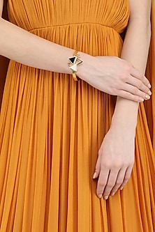 Gold Plated Mother Of Pearl Embellished Bracelet by Varnika Arora