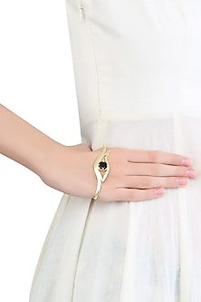 Gold Plated Black Onyx Stone Eye Shaped Palm Cuff by Varnika Arora