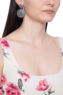 Silver plated green stone circular earrings by ZEROKAATA